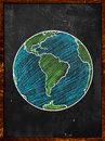 Green blue earth on blackboard globe background Stock Photos