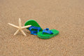 Green and blue flip flops with a star fish Royalty Free Stock Photo