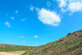 Green and blue hill under a sky in porticciolo sardinia Stock Image