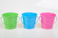 Green blue and pink pails buckets Stock Photo