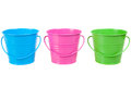 Green, blue and pink pails, buckets Royalty Free Stock Photos