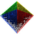 Green blue red yellow colored pyramidal maze structure Stock Photography