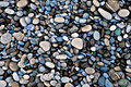 Green blue rocks on a beach (background, wallpaper) Royalty Free Stock Photo