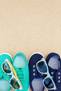 Green and blue sneakers and sunglasses on brown background Royalty Free Stock Photo