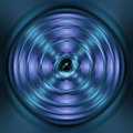 Green and blue spinning atom Royalty Free Stock Photo
