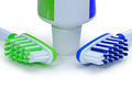 Green, blue toothbrushes and toothpaste isolated on a white back Royalty Free Stock Photo
