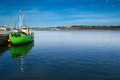 Green boat at dock Stock Image