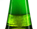 Green bottle of beer and gas bubbles Royalty Free Stock Photo