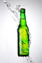 Green bottle beer water splash light background Stock Image