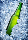 Green bottle in ice a cold blue Stock Photo