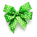 Green bow with dots polka dot ribbon on white background clipping path included Stock Photo