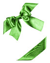 Green bow made from silk ribbon isolated Stock Photos