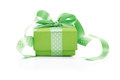 Green box tied with a ribbon with a gift Stock Images