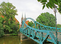 The green bridge wroclaw poland july tumski over oder river leads to wroclaw cathedral with high gothic spires on july in Royalty Free Stock Photos