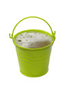 Green bucket with foaming liquid isolated on white background Royalty Free Stock Photos