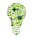 Green bulb with environmental icons Royalty Free Stock Photo