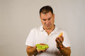 Green burger guy pretty unhappy with his full of vegetables Stock Photography