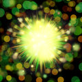 Green burst illustration over a blurry background with a bokeh effect Stock Photo