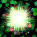 Green burst illustration over a blurry background with a bokeh effect Royalty Free Stock Photography