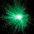 Green burst of light a radiating outward in rays Royalty Free Stock Photography