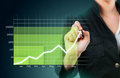 Green business graph showing growth close up Stock Photo