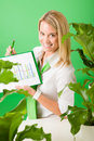 Green business office woman show charts plants Stock Image