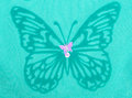 Green butterfly on fabric lace beads Stock Photo