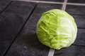 Green cabbage isolated on black wood background. Royalty Free Stock Photo