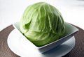 Green cabbage in white dish healthy head of Royalty Free Stock Image