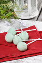Green cake pops on red napkin christmas dessert wooden table Royalty Free Stock Images