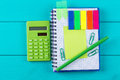 Green calculator with a paper sticker Royalty Free Stock Photo