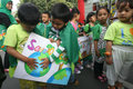 Green campaign kindergarten students in solo and called on citizens to care more about the environment Stock Image