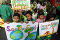Green campaign kindergarten students in solo and called on citizens to care more about the environment Stock Images