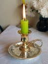 Green candle in candelabre burning on day time Stock Image