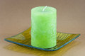 Green candle on the tray Royalty Free Stock Photo