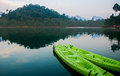 Green canoe in the lake on Sunrise time. Royalty Free Stock Photo