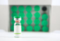 Green cap vial on vial cover background show medcine concept Royalty Free Stock Photo