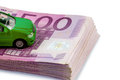 Green car on banknotes model symbolic photo for buying financing and costs Royalty Free Stock Image