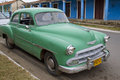 Green car parked on street in vinales cuba old classic the main the village of Royalty Free Stock Image