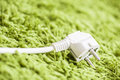 Green carpet power plug Stock Images