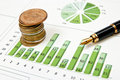Green chart, coins and pen Stock Images