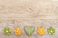 Green checked heart with flowers of cloth on wooden board Royalty Free Stock Photography