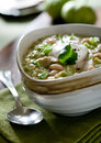 Green chicken chili closeup of a topped with sour cream and cilantro Royalty Free Stock Photography