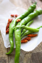 Green chilli peppers Stock Images