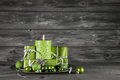 Green christmas decoration with candle and presents on wooden gr Royalty Free Stock Photo