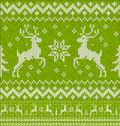 Green christmas knit with deers seamless pattern vector Royalty Free Stock Photos