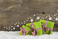 Green christmas presents on wooden background for a gift certifi Royalty Free Stock Photo