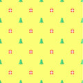 Green Christmas tree and gifts on yellow background