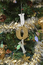 Green Christmas tree with lights and Joy ornament