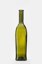 Green classic wine bottle studio shot on grey background Royalty Free Stock Image